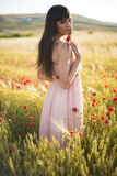 Portrait of a beautiful young woman outdoor in summer. Fields po Royalty Free Stock Photos