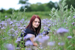 Portrait of a beautiful young woman outdoors. Shot in the field of flowers Stock Photo
