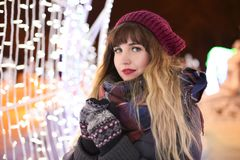 Portrait of beautiful young woman outdoors. On Christmas eve Stock Images