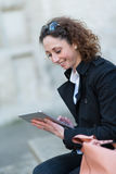 Portrait of a beautiful young woman outside with tablet Stock Photography