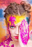 Portrait of beautiful young woman with paint on face Stock Photography