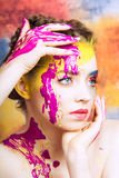 Portrait of beautiful young woman with paint on face Stock Image