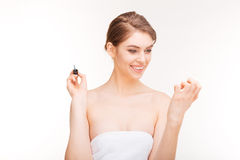 Portrait of beautiful young woman painting her nails Royalty Free Stock Photo