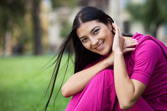 Portrait of beautiful young woman in park Stock Photo