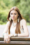 Portrait of beautiful young woman in the park. Stock Photography
