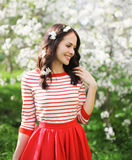 Portrait beautiful young woman with petals of flowers in hair Royalty Free Stock Image