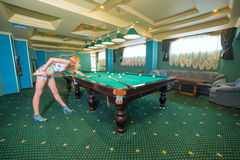 Portrait of Beautiful young woman playing. Billiards Royalty Free Stock Photos