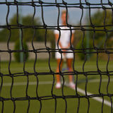 Portrait of beautiful young woman playing paddle tennis. Royalty Free Stock Photography