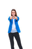 Portrait of a beautiful young woman pointing at you, isolated on white background Royalty Free Stock Photo