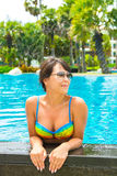 Portrait of a beautiful young woman in the pool Stock Image
