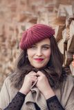 Portrait of a beautiful young woman. In a red hat Royalty Free Stock Images