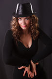 Portrait  of beautiful young woman posing. Glamour Portrait  of beautiful young woman  in black hat and brown long ringlets hair posing Stock Photos
