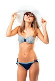 Portrait of a beautiful young woman posing in bikini, hat and su Royalty Free Stock Images