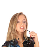 Portrait of a beautiful young woman posing with glasses. Studio Stock Photography