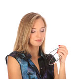 Portrait of a beautiful young woman posing with glasses. Studio Stock Images