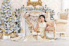 Portrait of beautiful young woman posing in room royalty free stock images