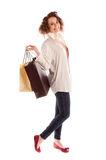 Portrait of a beautiful young woman posing with shopping bags Royalty Free Stock Image