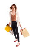 Portrait of a beautiful young woman posing with shopping bags Stock Photo