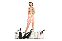 Portrait of a beautiful young woman posing with shopping bags, i Stock Images
