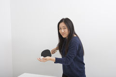 Portrait of beautiful young woman preparing to serve table tennis ball Royalty Free Stock Image