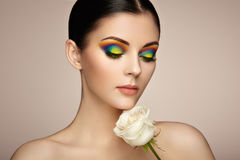 Portrait of beautiful young woman with rainbow make-up Stock Photos