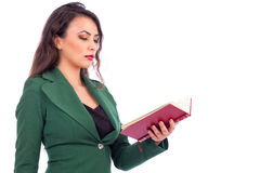 Portrait of a beautiful young woman reading  a book Royalty Free Stock Image