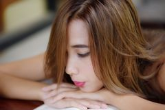 Portrait of a beautiful young woman reading a book Relaxing and comfortable royalty free stock images