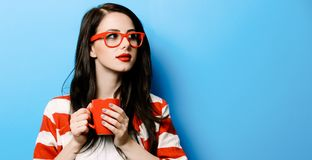 Portrait of the young woman with cup of coffee royalty free stock photo