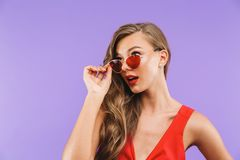 Portrait of a beautiful young woman in red dress Royalty Free Stock Photography
