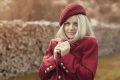 Portrait of a beautiful young woman. In a red hat Royalty Free Stock Photo