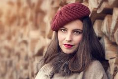 Beautiful young woman in a red hat. Portrait of a beautiful young woman in a red hat Stock Photos