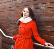 Portrait of beautiful young woman in red jacket Royalty Free Stock Photography
