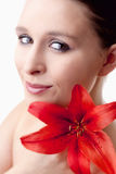 Portrait of a Beautiful Young Woman with Red Lily Stock Image