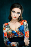 Portrait of beautiful young woman with red lips dressed in a bright blouse Royalty Free Stock Photo