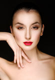 Portrait of beautiful young woman with red lipstick on black bac Stock Photos