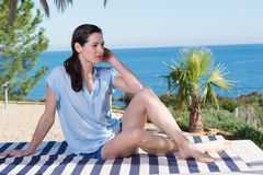 Portrait of beautiful young woman relaxing on vacation Stock Photos