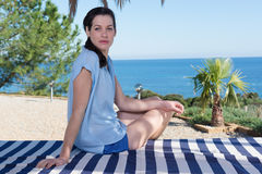 Portrait of beautiful young woman relaxing on vacation Royalty Free Stock Images
