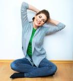 Portrait of beautiful young woman relaxing yoga poseonfloor. Stock Image