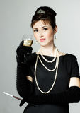 Portrait of a beautiful young woman in retro style with cigarett Royalty Free Stock Images