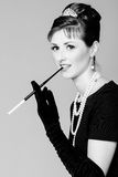 Portrait of a beautiful young woman in retro style with cigarett Stock Photography