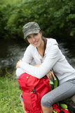 Portrait of a beautiful young woman by the river Royalty Free Stock Image