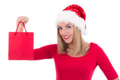 Portrait of beautiful young woman in santa hat with gift bag iso Royalty Free Stock Image