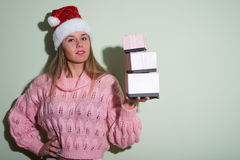 Portrait of beautiful young woman in Santa hat Stock Image