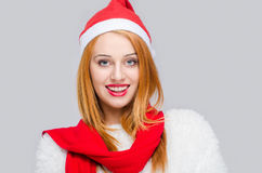 Portrait of a beautiful young woman with Santa hat smiling. Stock Images