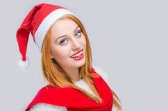 Portrait of a beautiful young woman with Santa hat smiling. Royalty Free Stock Photography