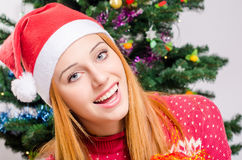 Portrait of a beautiful young woman with Santa hat smiling. Royalty Free Stock Image