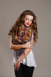 Portrait of a beautiful young woman with a scarf. Stock Photo