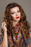 Portrait of a beautiful young woman with a scarf. Beautiful oriental look. portrait of a beautiful young woman with a scarf. Russian beauty. Russian national Royalty Free Stock Image