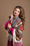 Portrait of a beautiful young woman with a scarf. Royalty Free Stock Image