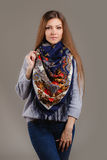 Portrait of a beautiful young woman with a scarf. Royalty Free Stock Photography